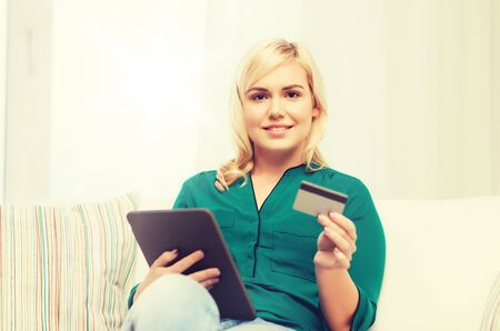 emoney: happy woman with tablet pc and credit card