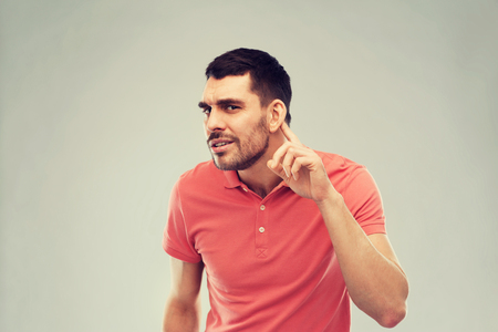 man having hearing problem listening to something Stockfoto