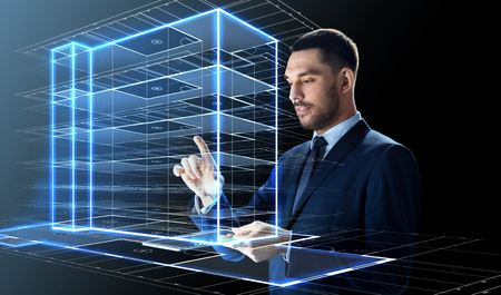 businessman with tablet pc and building hologram