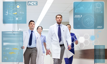 people, healthcare and medicine concept - group of medics walking along hospital