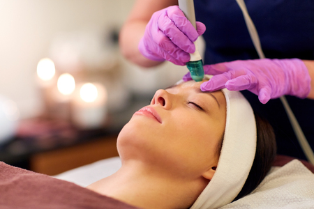 woman having microdermabrasion facial treatment Stock Photo