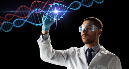 science, research and genetics concept - young scientist in safety glasses with test tube and virtual projection of dna molecule