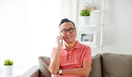 happy man calling on smartphone at home 版權商用圖片