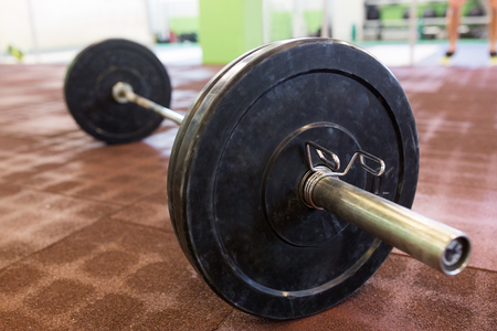 barbell on floor in gym