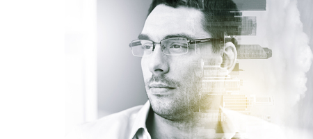 city buildings: business, vision and people concept - portrait of businessman in eyeglasses at office over city buildings and double exposure effect Stock Photo