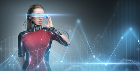 augmented reality, technology, business, future and people concept - woman in virtual glasses and microchip implant or sensors looking at diagram chart projection