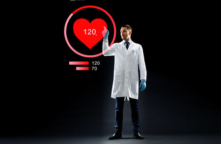 medicine, cardiology and healthcare concept - doctor or scientist in white coat and medical gloves with heart rate projection over black background