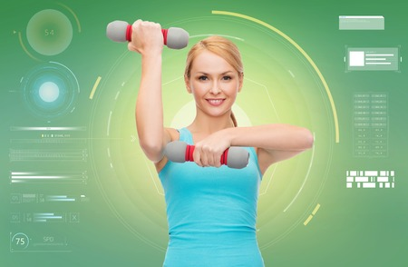 happy sporty woman with dumbbells flexing biceps photo
