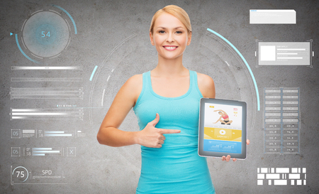 sporty woman with fitness application on tablet pc photo