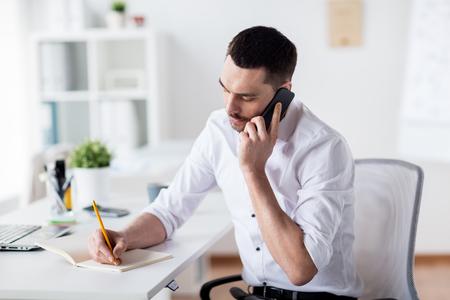 businessman calling on smartphone at office Фото со стока