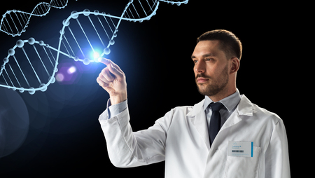 science, genetics and people concept - doctor or scientist in white coat with dna molecule projection over black background