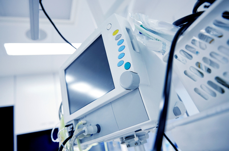 anaesthetic: medicine, health care, emergency and medical equipment concept - extracorporeal life support machine at hospital ward or operating room
