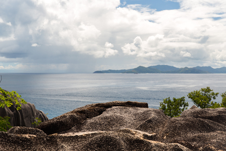 travel, seascape and nature concept - view from island to indian ocean on seychelles