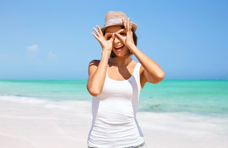 happy young woman in hat on summer beach photo