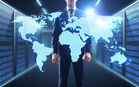 business, people and technology concept - businessman with virtual world map projection over server room background Stock Photo