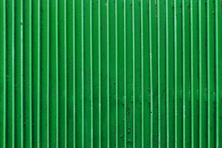 texture and background concept - old green painted metal ribbed surface Фото со стока