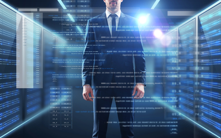 business, people and technology concept - businessman in suit with coding on virtual screen over server room background