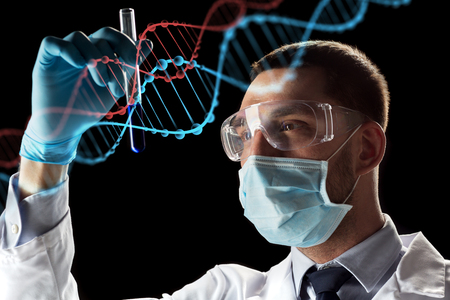 science, research and genetics concept - young scientist in safety glasses, face mask with test tube and virtual projection of dna molecule