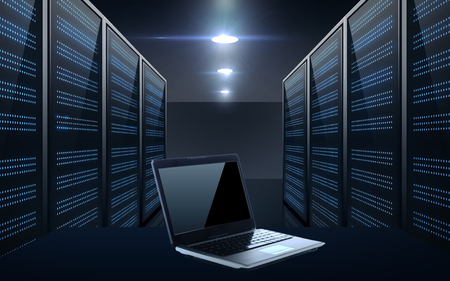 laptop computer over server room background Stock Photo