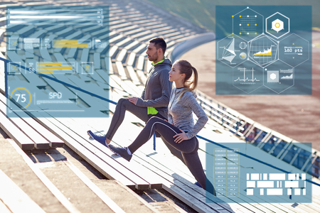 warming up: sporty couple stretching leg on stands of stadium