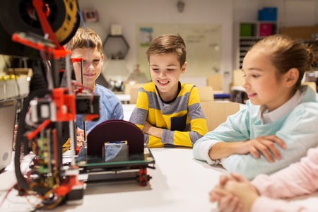 prototyping: happy children with 3d printer at robotics school Stock Photo