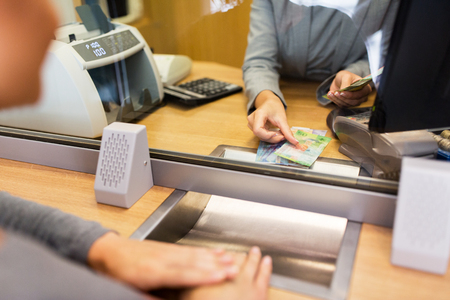 clerk counting cash money at bank office Stock fotó