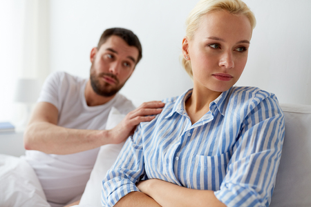 unhappy couple having conflict in bed at home Stock Photo