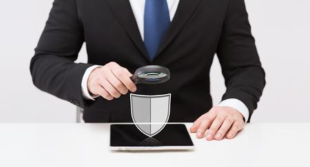 businessman with tablet pc antivirus program icon Stock Photo