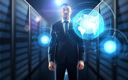 business, people and technology concept - businessman with virtual world map projection over server room background Stock fotó