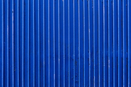 old blue painted metal ribbed surface