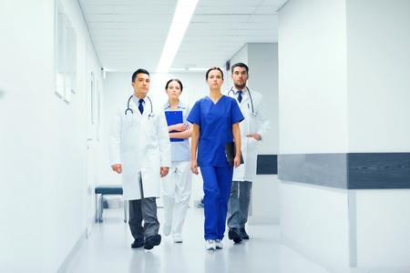 corridors: group of medics or doctors at hospital corridor Stock Photo