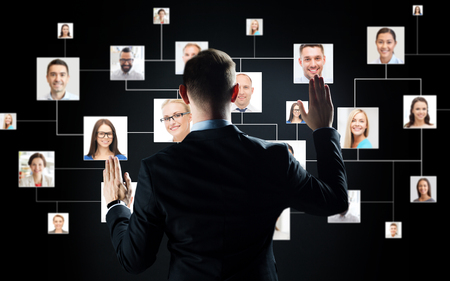 businessman with virtual contact icons Stock Photo