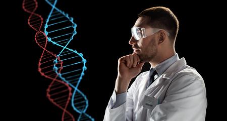 scientist in goggles looking at dna molecule