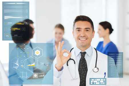 happy doctor showing ok hand sign at hospital