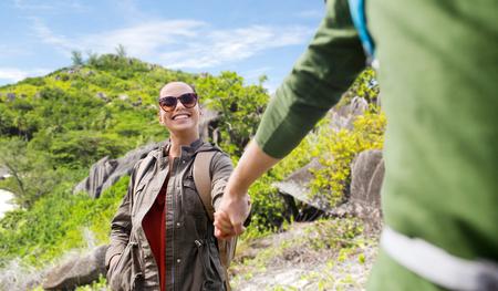 couple with backpacks traveling around island Stock Photo