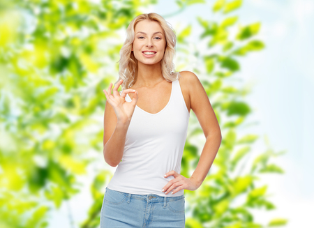 happy young woman showing ok hand sigh Stock Photo