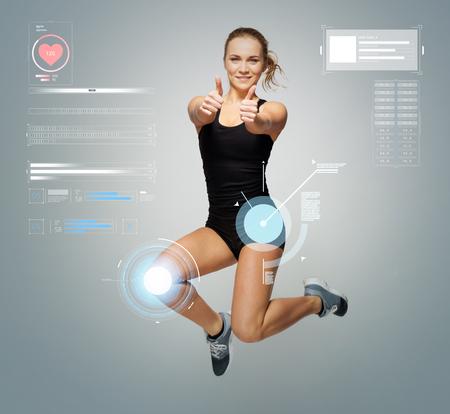 여자 점프와 엄지 손가락을 보여주는 운동복에 스톡 콘텐츠 - 80531702