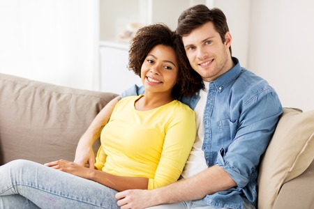 happy smiling international couple at home Stock Photo