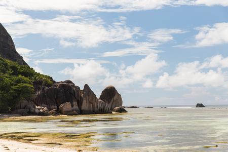 la digue: rocks on seychelles island beach in indian ocean
