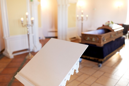 stand or tribune and coffin in church Stock Photo
