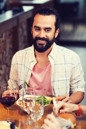 happy man having dinner at restaurant