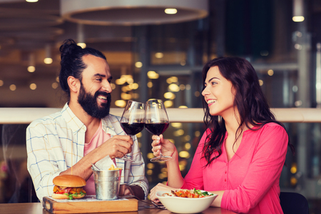 happy couple dining and drink wine at restaurant Stock Photo