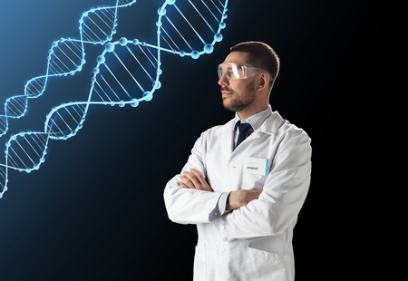 scientist in lab coat and safety glasses with dna