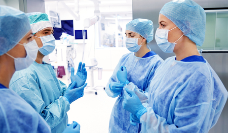 group of surgeons in operating room at hospital Stock Photo