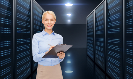 businessman with clipboard over server room