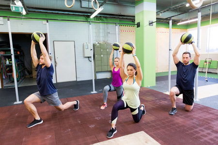 group of people with medicine ball training in gym Banco de Imagens