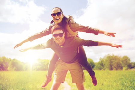 happy couple with backpacks having fun outdoors Archivio Fotografico