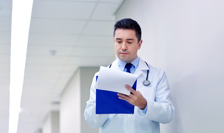 doctor with clipboard at hospital corridor Stock Photo