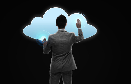 businessman working with virtual cloud projection Stock Photo