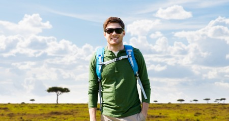 happy young man with backpack traveling in africa Stock fotó
